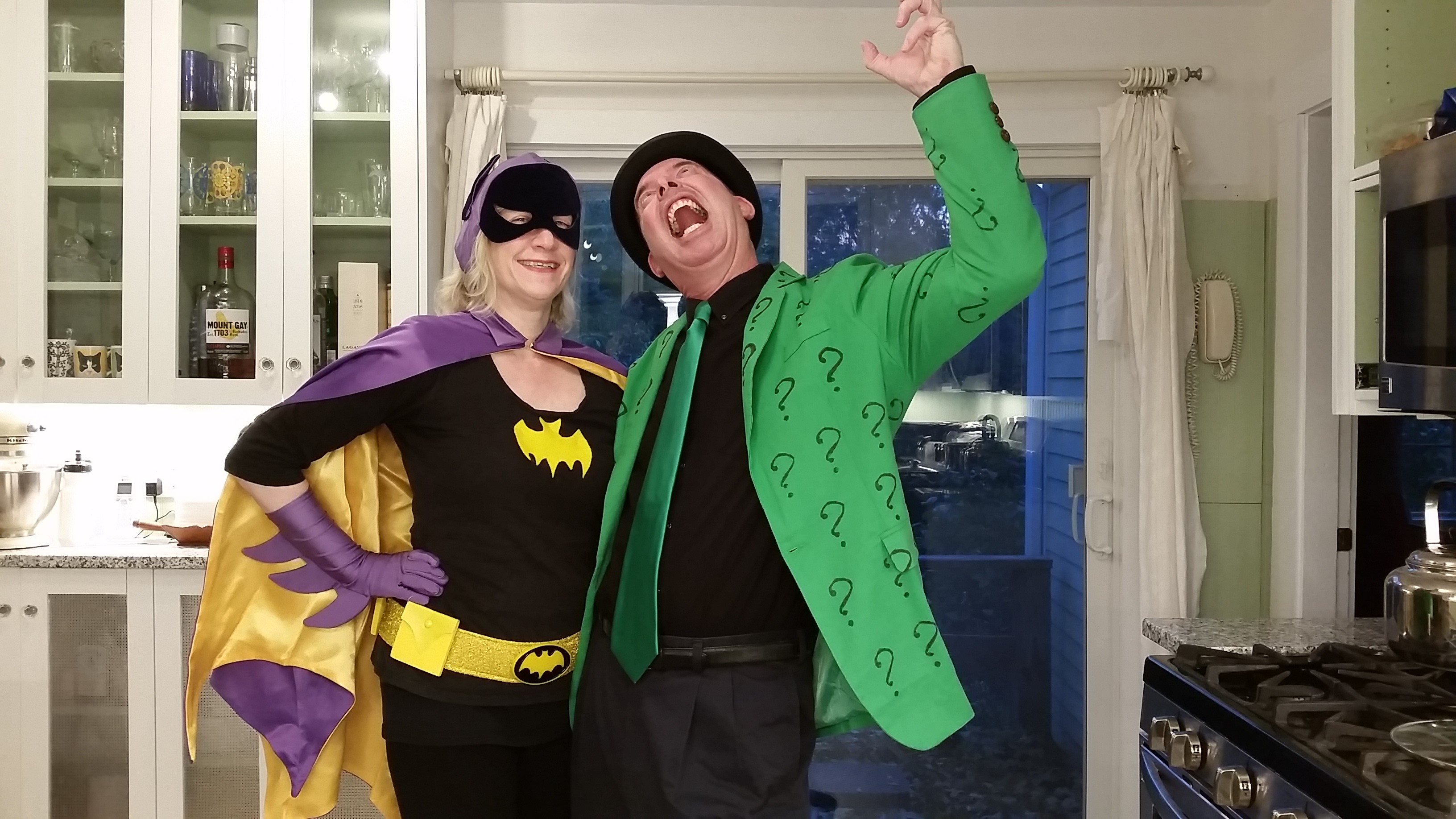 Abby Kingsbury dressed as Batgirl and her husband dressed as The Riddler