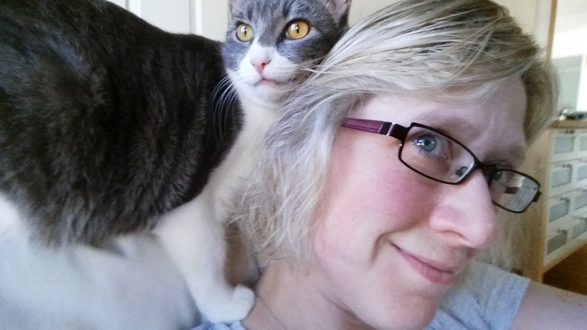 Abby Kingsbury and a grey and white cat